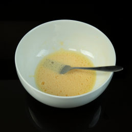 egg mixed in a bowl