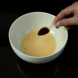 spoonful of liquid additive